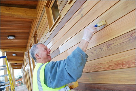 Midland Chandlers cedar facade at Mercia Marina gets a final varnish