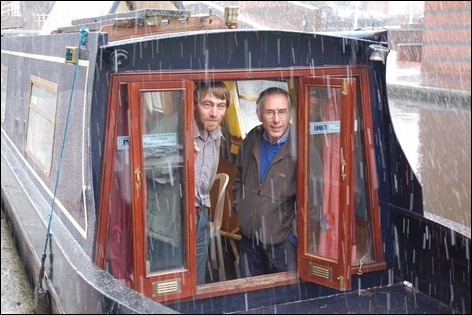 Mike Rolfe and Ivor Caplan aboard IWA campaign boat Jubilee in the sleet in Birmingham, January 2006