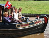 Canadians fly the flag on a canal boat